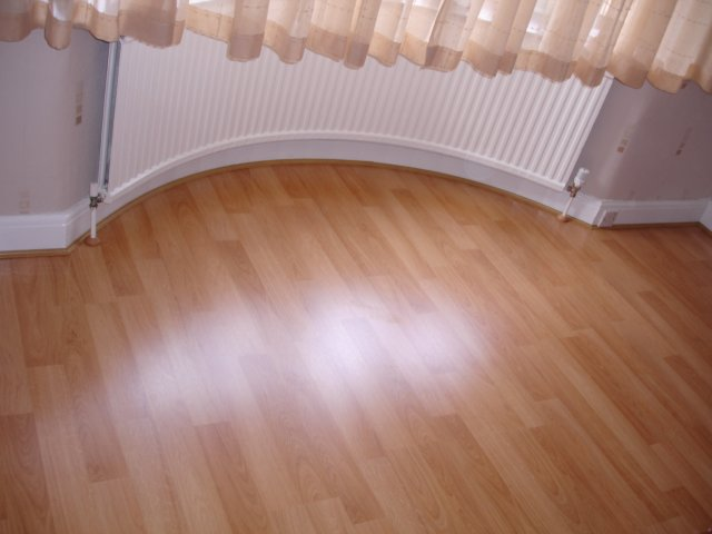 Curved Beading Under Radiator With Laminate Flooring