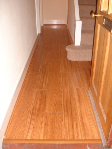 Laminate flooring laying laminate flooring hallway for Laying laminate flooring