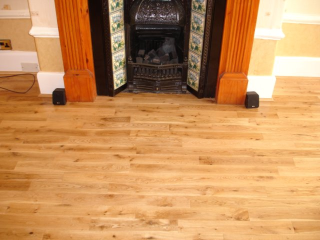 Solid wood dipped under fireplace for Wood floor up to fireplace